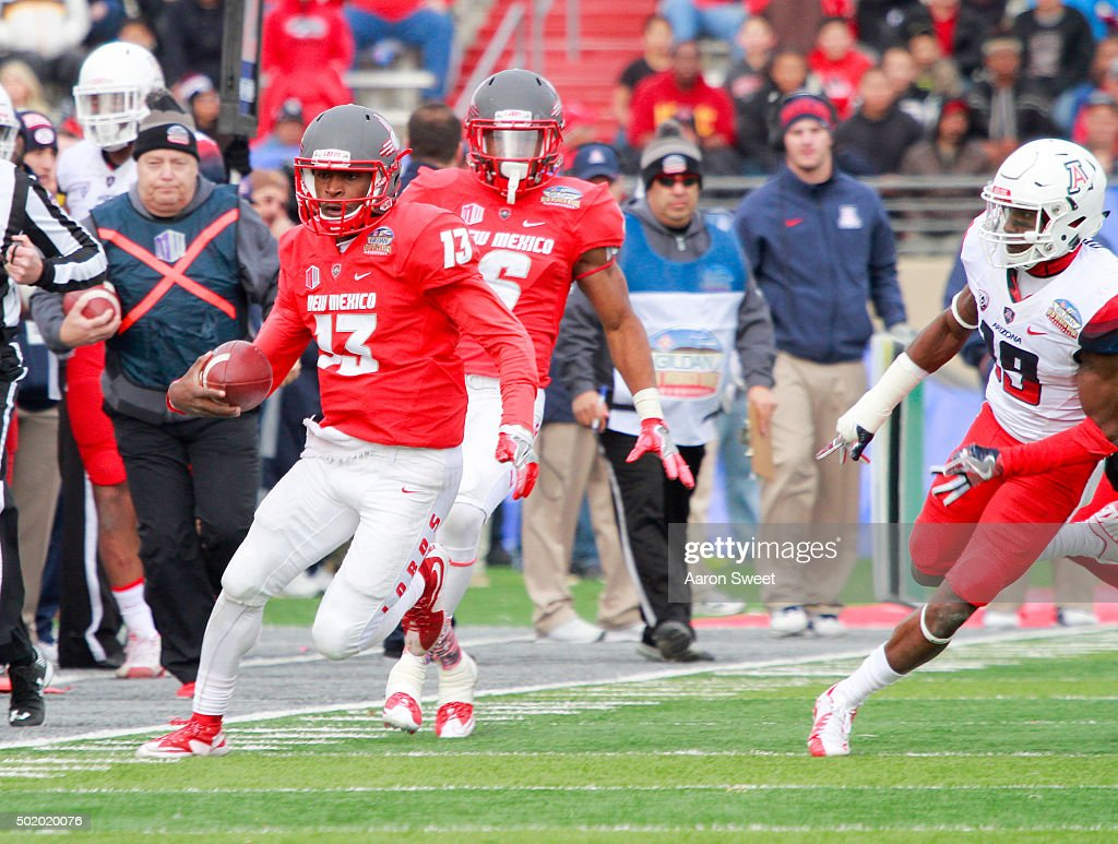 Quarterback Lamar Jordan #13 of the New Mexico Lobos runs the ball with cornerback DavonteÕ Neal #19 of the Arizona Wildcats gives chase during the first half of the New Mexico Bowl at University Stadium on December 19, 2015 in Albuquerque, New Mexico. Arizona won 45-37.