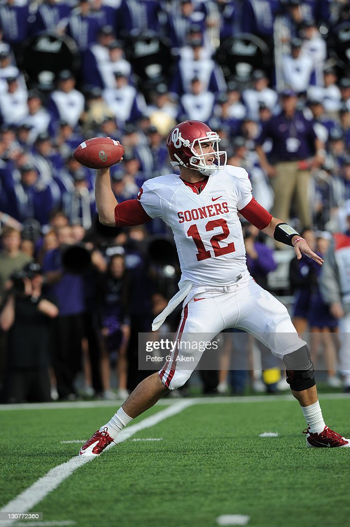 Quarterback <a gi-track='captionPersonalityLinkClicked' href=/galleries/search?phrase=Landry+Jones&family=editorial&specificpeople=5572476 ng-click='$event.stopPropagation()'>Landry Jones</a> #12 of the Oklahoma Sooners throws a pass down field against the Kansas State Wildcats during the first quarter on October 29, 2011 at Bill Snyder Family Stadium in Manhattan, Kansas. Oklahoma defeated Kansas State 58-17.