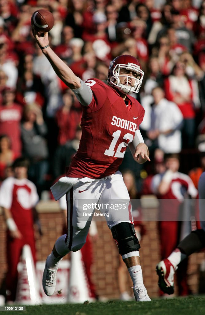 Quarterback Landry Jones #12 of the Oklahoma Sooners throws against the Oklahoma State Cowboys November 24, 2012 at Gaylord Family-Oklahoma Memorial Stadium in Norman, Oklahoma. Oklahoma defeated Oklahoma State 51-48 in overtime.