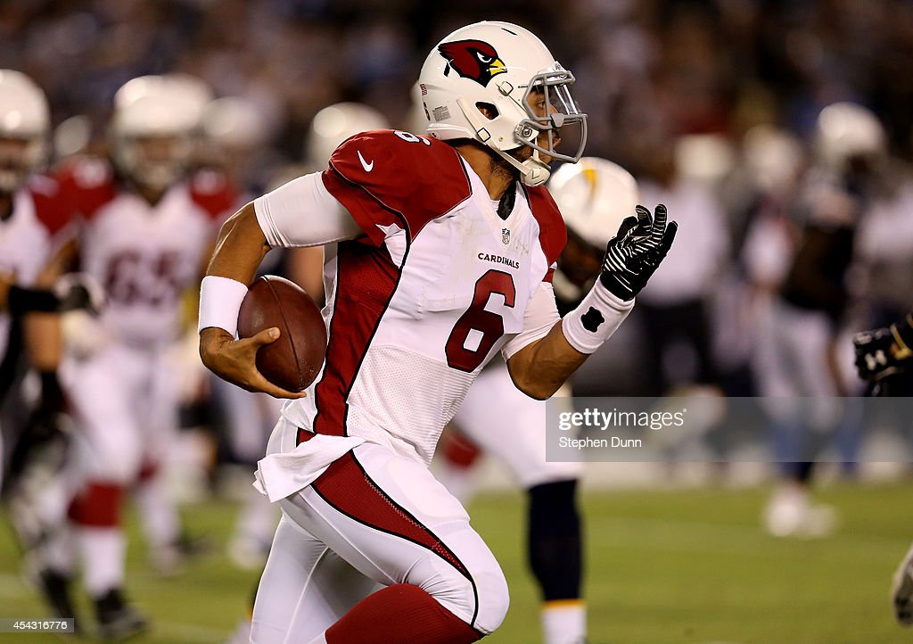 Quarterback Logan Thomas #6 of the Arizona Cardinals carries the ball against the San Diego Chargers at Qualcomm Stadium on August 28, 2014 in San Diego, California.