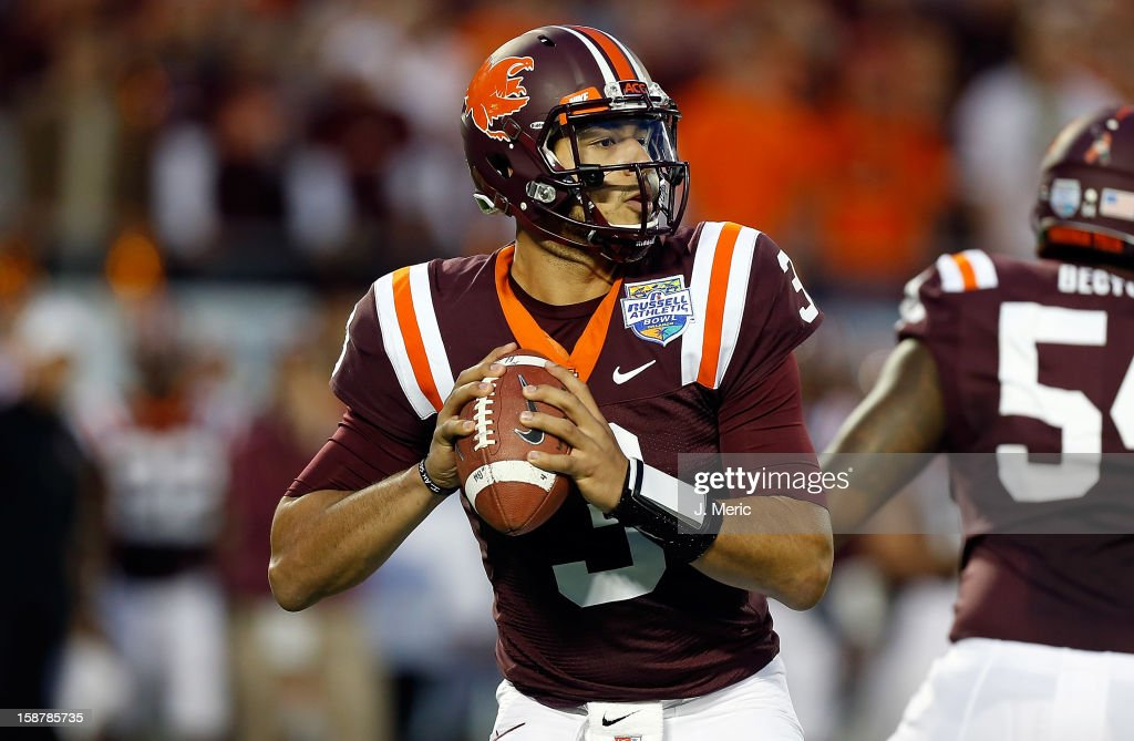 Quarterback <a gi-track='captionPersonalityLinkClicked' href=/galleries/search?phrase=Logan+Thomas&family=editorial&specificpeople=6787143 ng-click='$event.stopPropagation()'>Logan Thomas</a> #3 of the Virginia Tech Hokies looks for an open receiver against the Rutgers Scarlet Knights during the Russell Athletic Bowl Game at the Florida Citrus Bowl on December 28, 2012 in Orlando, Florida.