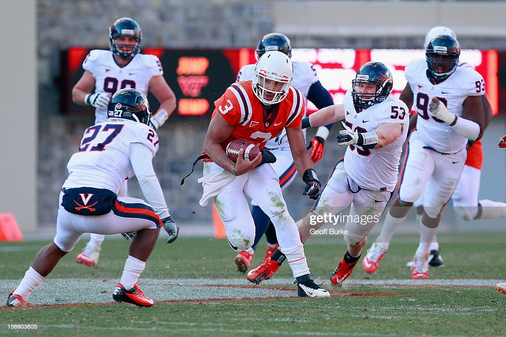 Quarterback <a gi-track='captionPersonalityLinkClicked' href=/galleries/search?phrase=Logan+Thomas&family=editorial&specificpeople=6787143 ng-click='$event.stopPropagation()'>Logan Thomas</a> #3 of the Virginia Tech Hokies runs with the ball as linebacker Steve Greer #53 of the Virginia Cavaliers and safety Rijo Walker #27 of the Cavaliers chase at Lane Stadium on November 24, 2012 in Blacksburg, Virginia.