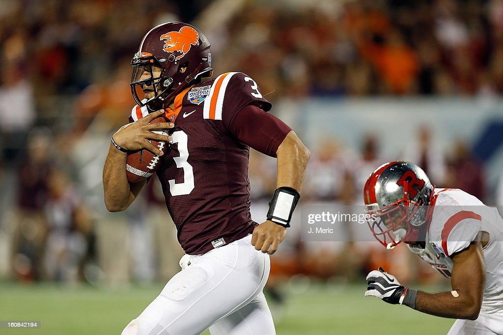 Quarterback Logan Thomas #3 of the Virginia Tech Hokies scrambles against the Rutgers Scarlet Knights during the Russell Athletic Bowl Game at the Florida Citrus Bowl on December 28, 2012 in Orlando, Florida.
