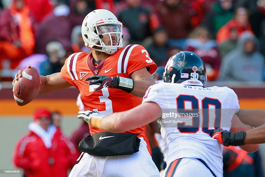 Quarterback <a gi-track='captionPersonalityLinkClicked' href=/galleries/search?phrase=Logan+Thomas&family=editorial&specificpeople=6787143 ng-click='$event.stopPropagation()'>Logan Thomas</a> #3 of the Virginia Tech Hokies throws the ball as defensive end Jake Snyder #90 of the Virginia Cavaliers chases at Lane Stadium on November 24, 2012 in Blacksburg, Virginia.