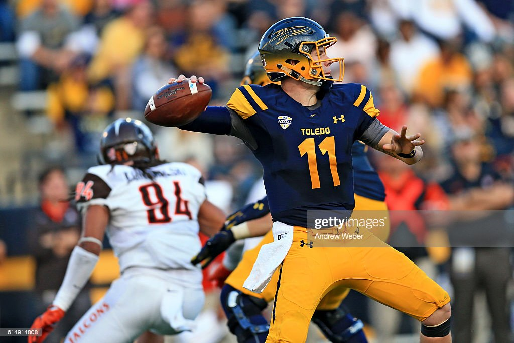 Quarterback Logan Woodside #11 of the Toledo Rockets throws a pass during the fourth quarter against Bowling Green Falcons of at Glass Bowl on October 15, 2016 in Toledo, Ohio.