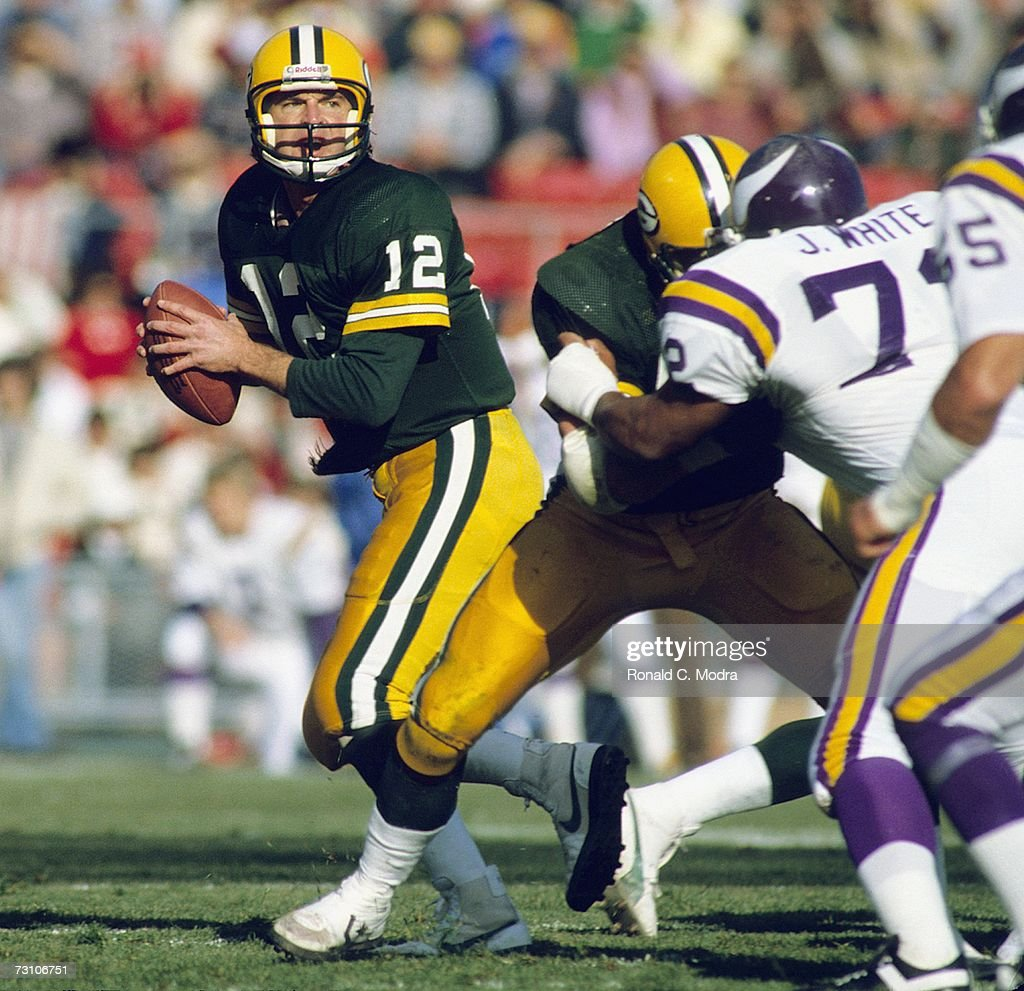 Quarterback Lynn Dickey of the Green Bay Packers goes back to pass in a game against the Minnesota Vikings on October 17 1983 in Green Bay Wisconsin