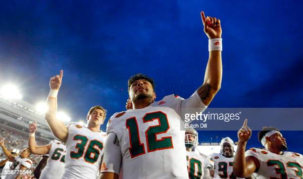 Quarterback Malik Rosier of the Miami Hurricanes celebrates with teammates after they defeated the Florida State Seminoles 2420 during the second...