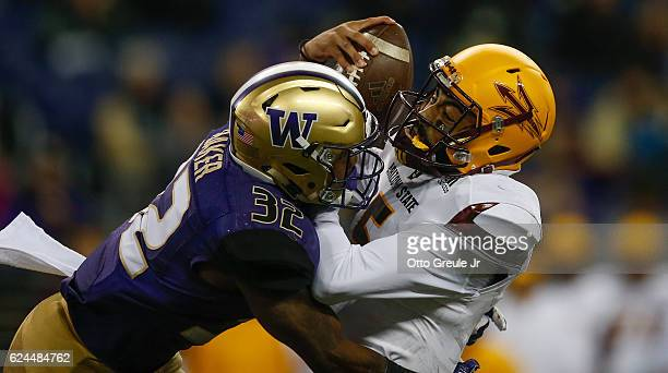 Quarterback Manny Wilkins of the Arizona State Sun Devils is sacked by defensive back Budda Baker of the Washington Huskies on November 19 2016 at...