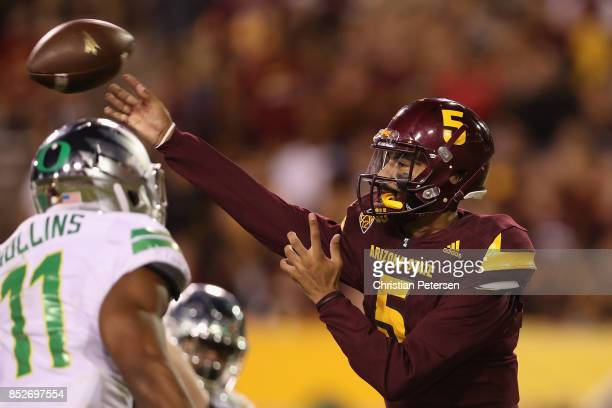 Quarterback Manny Wilkins of the Arizona State Sun Devils throws a pass during the second half of the college football game against the Oregon Ducks...