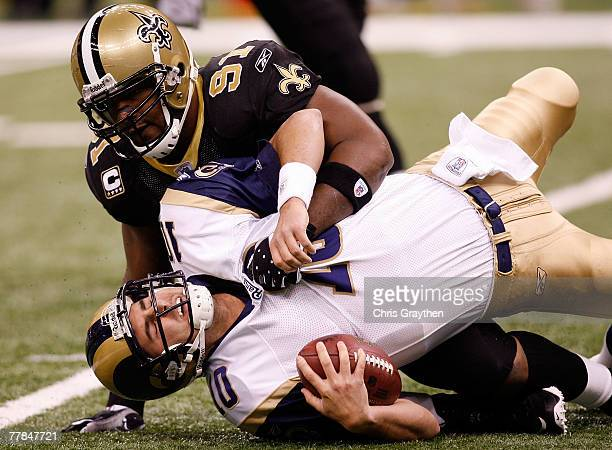 Quarterback Marc Bulger of the St Louis Rams is sacked by Will Smith of the New Orleans Saints at the Louisiana Superdome November 11 2007 in New...