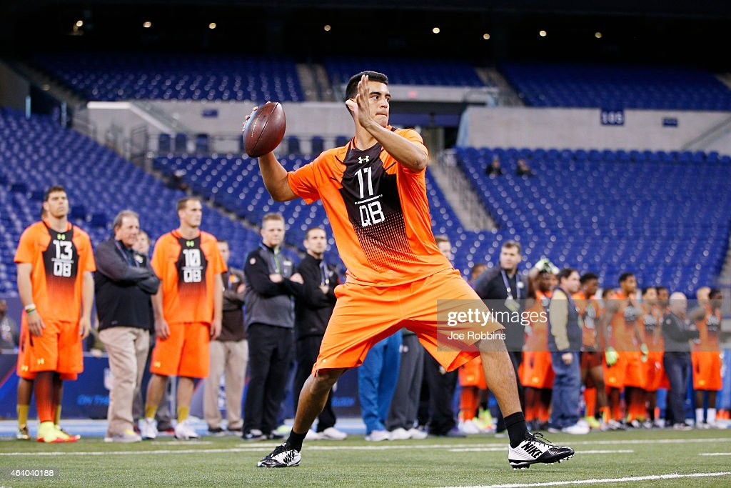 Quarterback Marcus Mariota of Oregon throws a pass during the 2015 NFL Scouting Combine at Lucas Oil Stadium on February 21 2015 in Indianapolis...