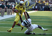 EUGENE OR SEPTEMBER 06 Quarterback Marcus Mariota of the Oregon Ducks is brought down by safety RJ Williamson of the Michigan State Spartans in the...