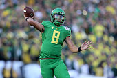 Quarterback Marcus Mariota of the Oregon Ducks looks to pass the ball against the Florida State Seminoles during the College Football Playoff...
