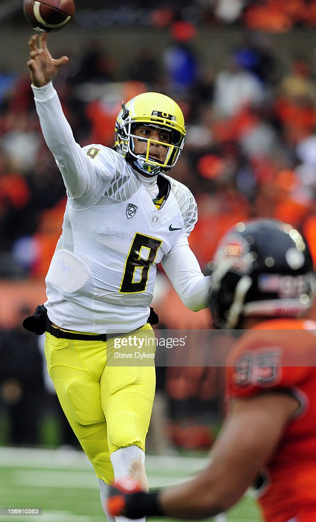 Quarterback <a gi-track='captionPersonalityLinkClicked' href=/galleries/search?phrase=Marcus+Mariota&family=editorial&specificpeople=8572256 ng-click='$event.stopPropagation()'>Marcus Mariota</a> #8 of the Oregon Ducks passes the ball in the third quarter of the game against the Oregon State Beavers on November 24, 2012 at Reser Stadium in Corvallis, Oregon. Oregon won the game 48-24.