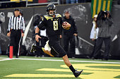 Quarterback Marcus Mariota of the Oregon Ducks runs in for a touch down during the first quarter of the game against the Stanford Cardinal at Autzen...