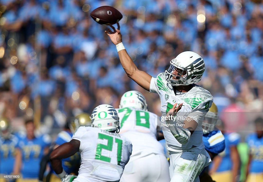 Quarterback <a gi-track='captionPersonalityLinkClicked' href=/galleries/search?phrase=Marcus+Mariota&family=editorial&specificpeople=8572256 ng-click='$event.stopPropagation()'>Marcus Mariota</a> #8 of the Oregon Ducks throws a pass against the UCLA Bruins at the Rose Bowl on October 11, 2014 in Pasadena, California. Oregon won 42-30.