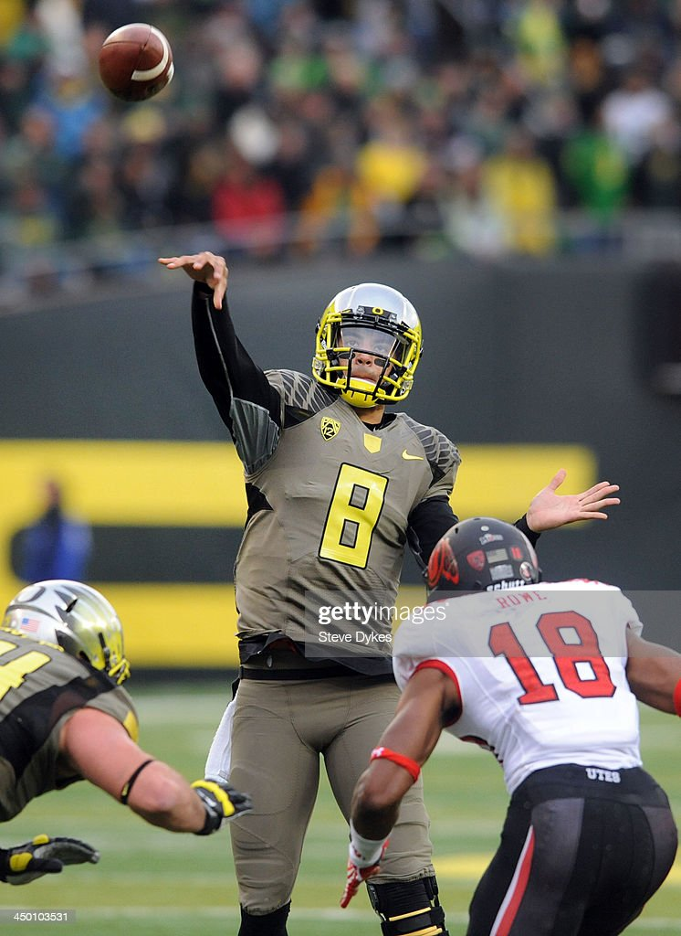 Quarterback <a gi-track='captionPersonalityLinkClicked' href=/galleries/search?phrase=Marcus+Mariota&family=editorial&specificpeople=8572256 ng-click='$event.stopPropagation()'>Marcus Mariota</a> #8 of the Oregon Ducks throws a touchdown pass during the third quarter of the game against the Utah Utes at Autzen Stadium on November 16, 2013 in Eugene, Oregon.