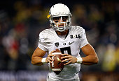 Quarterback Marcus Mariota of the Oregon Ducks warms up prior to the College Football Playoff National Championship Game against the Ohio State...