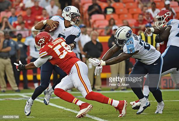 Quarterback Marcus Mariota of the Tennessee Titans avoids pressure from linebacker Derrick Johnson of Kansas City Chiefs during the first half of a...