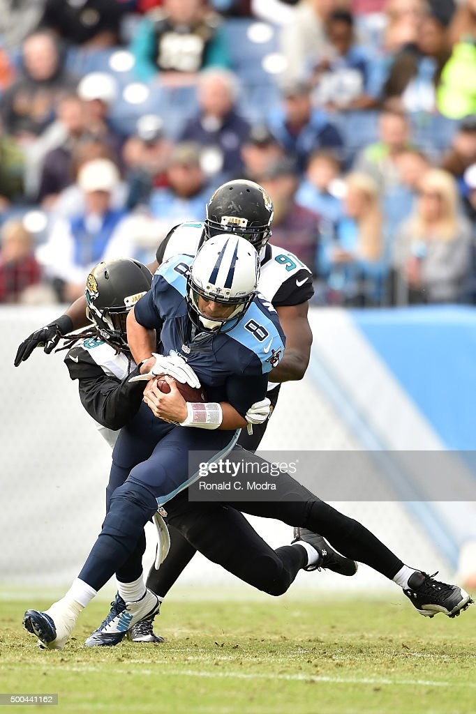 Quarterback <a gi-track='captionPersonalityLinkClicked' href=/galleries/search?phrase=Marcus+Mariota&family=editorial&specificpeople=8572256 ng-click='$event.stopPropagation()'>Marcus Mariota</a> #8 of the Tennessee Titans gets tackled by <a gi-track='captionPersonalityLinkClicked' href=/galleries/search?phrase=B.W.+Webb&family=editorial&specificpeople=7308996 ng-click='$event.stopPropagation()'>B.W. Webb</a> #38 of the Jacksonville Jaguars during a NFL game at Nissan Stadium on December 6, 2015 in Nashville, Tennessee.