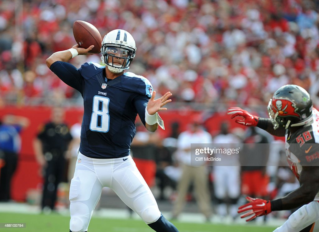 Quarterback <a gi-track='captionPersonalityLinkClicked' href=/galleries/search?phrase=Marcus+Mariota&family=editorial&specificpeople=8572256 ng-click='$event.stopPropagation()'>Marcus Mariota</a> #8 of the Tennessee Titans throws a twelve yard TD against the Tampa Bay Buccaneers in the first quarter at Raymond James Stadium on September 13, 2015 in Tampa, Florida.