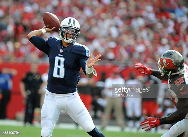 Quarterback Marcus Mariota of the Tennessee Titans throws a twelve yard TD against the Tampa Bay Buccaneers in the first quarter at Raymond James...