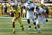 EUGENE OR SEPTEMBER 06 Quarterback Marcus Mariota runs the ball in the first quarter of the game against the Michigan State Spartans at Autzen...