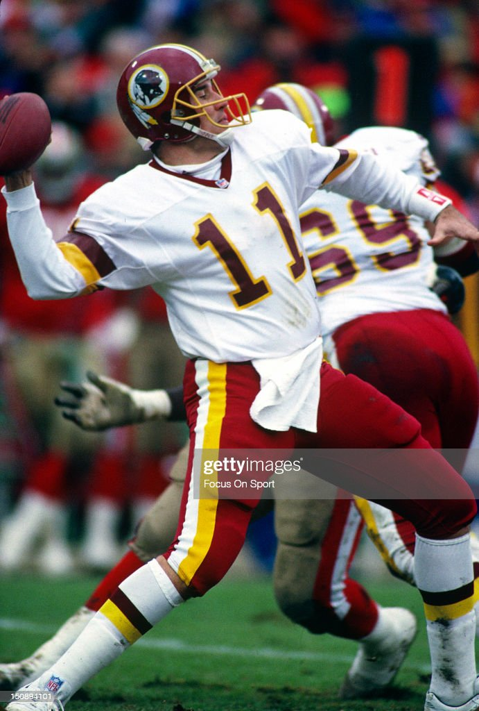 Quarterback Mark Rypien #11 of the Washington Redskins drops back to pass against the San Francisco 49ers during the NFC/NFL Divisional Playoffs at Candlestick Park January 9, 1993 in San Francisco, California. Rypien played for the Redskins from 1986-93.