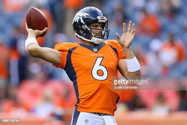 Quarterback Mark Sanchez of the Denver Broncos warms up before a game against the Los Angeles Rams at Sports Authority Field at Mile High on August...
