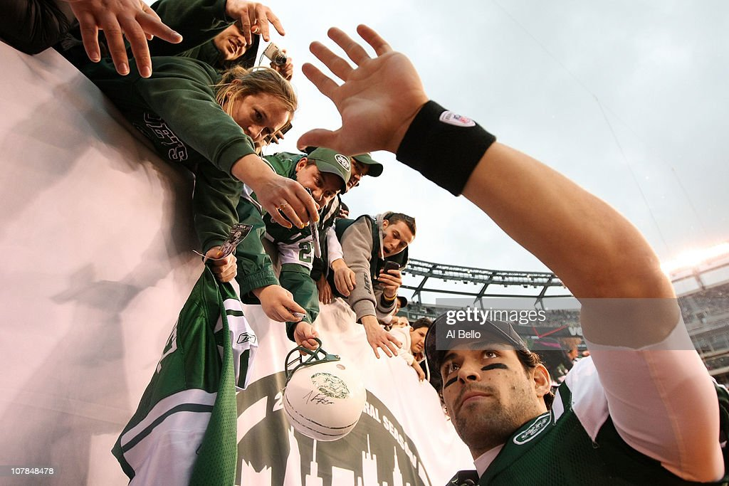 Quarterback Mark Sanchez #6 of the New York Jets celebrates with fans after they defeated the Buffalo Bills 38 to 7 at New Meadowlands Stadium on January 2, 2011 in East Rutherford, New Jersey.