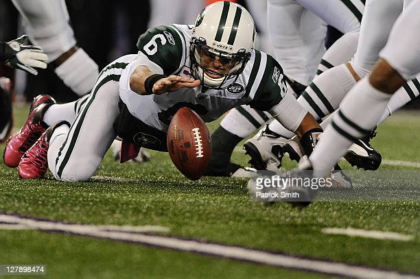 Quarterback Mark Sanchez of the New York Jets fumbles a snap against the Baltimore Ravens in the first quarter at MT Bank Stadium on October 2 2011...