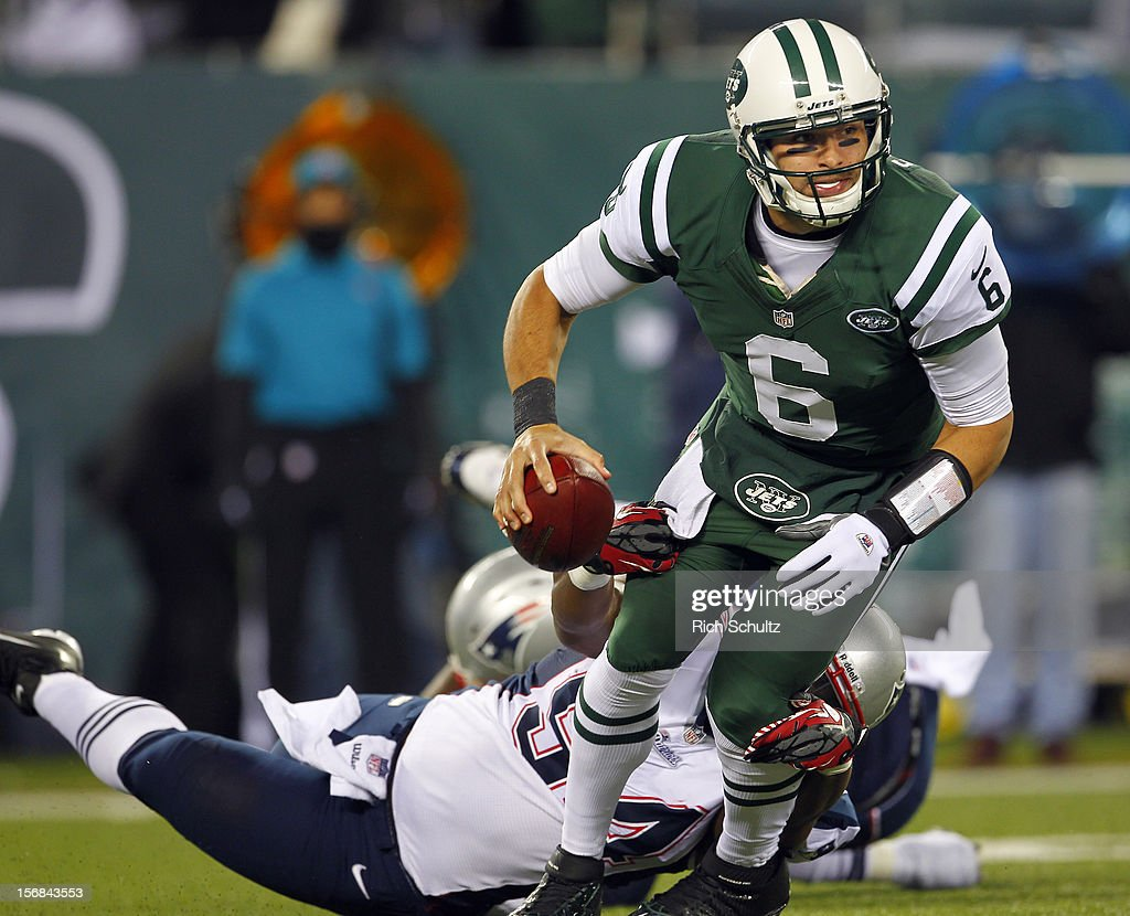 Quarterback <a gi-track='captionPersonalityLinkClicked' href=/galleries/search?phrase=Mark+Sanchez&family=editorial&specificpeople=690406 ng-click='$event.stopPropagation()'>Mark Sanchez</a> #6 of the New York Jets is sacked by Justin Francis #94 of the New England Patriots during the first half of a game at MetLife Stadium on November 22, 2012 in East Rutherford, New Jersey. The Patriots defeated the Jets 49-19.