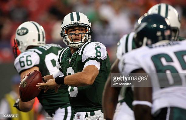 Quarterback Mark Sanchez of the New York Jets looks to make a pass play in the first quarter against the Philadelphia Eagles during the NFL preseason...