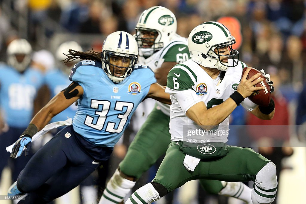 Quarterback <a gi-track='captionPersonalityLinkClicked' href=/galleries/search?phrase=Mark+Sanchez&family=editorial&specificpeople=690406 ng-click='$event.stopPropagation()'>Mark Sanchez</a> #6 of the New York Jets looks to throw the ball against free safety Michael Griffin #33 of the Tennessee Titans at LP Field on December 17, 2012 in Nashville, Tennessee.