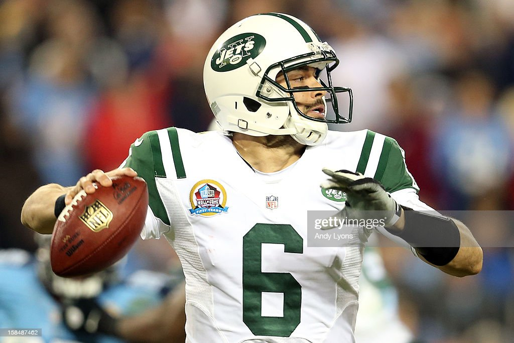 Quarterback <a gi-track='captionPersonalityLinkClicked' href=/galleries/search?phrase=Mark+Sanchez&family=editorial&specificpeople=690406 ng-click='$event.stopPropagation()'>Mark Sanchez</a> #6 of the New York Jets looks to throw the ball against the Tennessee Titans at LP Field on December 17, 2012 in Nashville, Tennessee.