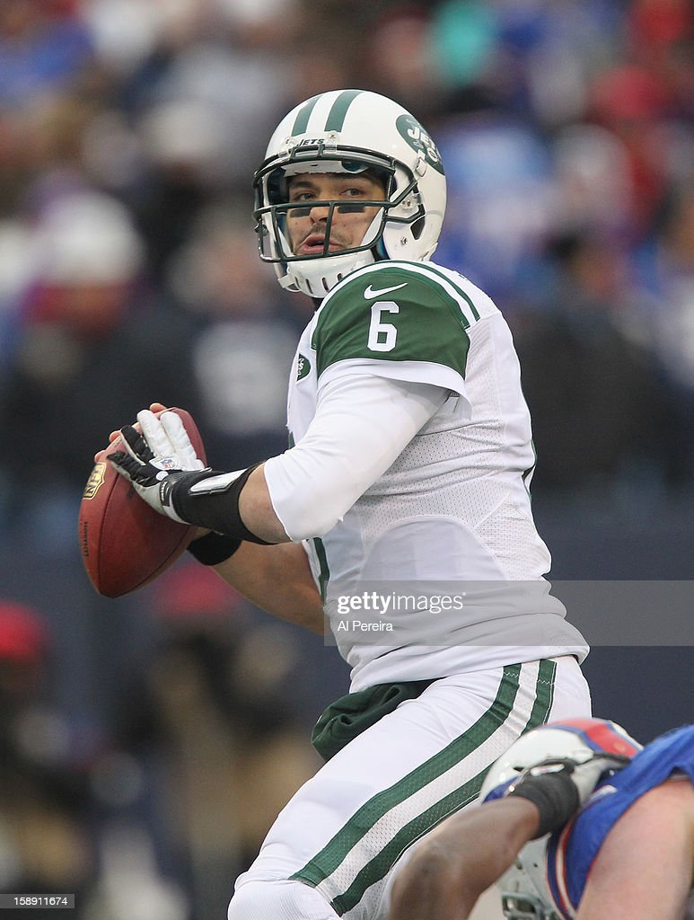 Quarterback Mark Sanchez #6 of the New York Jets passes the ball against the Buffalo Bills when the Buffalo Bills host the New York Jets at Ralph Wilson Stadium on December 30, 2012 in Orchard Park, New York.
