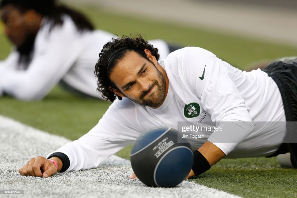 Quarterback <a gi-track='captionPersonalityLinkClicked' href=/galleries/search?phrase=Mark+Sanchez&family=editorial&specificpeople=690406 ng-click='$event.stopPropagation()'>Mark Sanchez</a> #6 of the New York Jets stretches before the Jets take on the New England Patriots at Gillette Stadium on September 12, 2013 in Foxboro, Massachusetts.