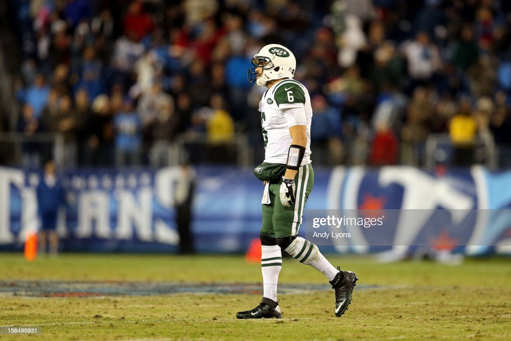 Quarterback <a gi-track='captionPersonalityLinkClicked' href=/galleries/search?phrase=Mark+Sanchez&family=editorial&specificpeople=690406 ng-click='$event.stopPropagation()'>Mark Sanchez</a> #6 of the New York Jets walks off the field after a play in the fourth quarter against the Tennessee Titans at LP Field on December 17, 2012 in Nashville, Tennessee.