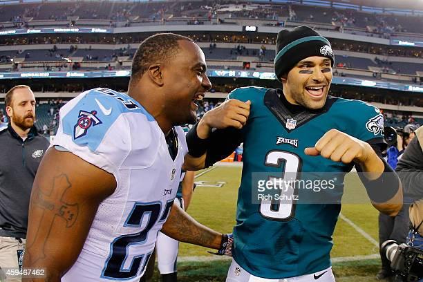 Quarterback Mark Sanchez of the Philadelphia Eagles celebrates their 4324 over the Tennessee Titans alongside Shonn Greene of the Tennessee Titans...