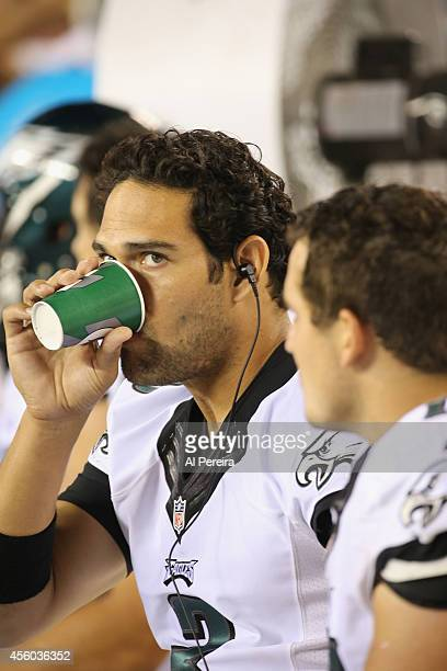 Quarterback Mark Sanchez of The Philadelphia Eagles drinks Gatorade and follows the action against the New York Jets during a preseason game at...