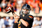 Quarterback Mason Rudolph of the Oklahoma State Cowboys looks to throw against the TCU Horned Frogs November 7 2015 at Boone Pickens Stadium in...