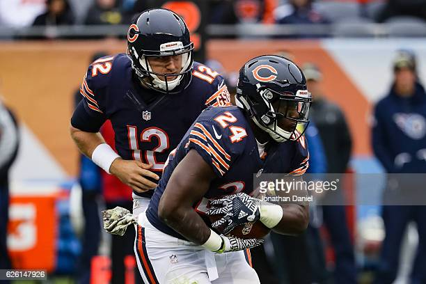 Quarterback Matt Barkley of the Chicago Bears hands the football offsides to Jordan Howard in the second quarter against the Tennessee Titans at...