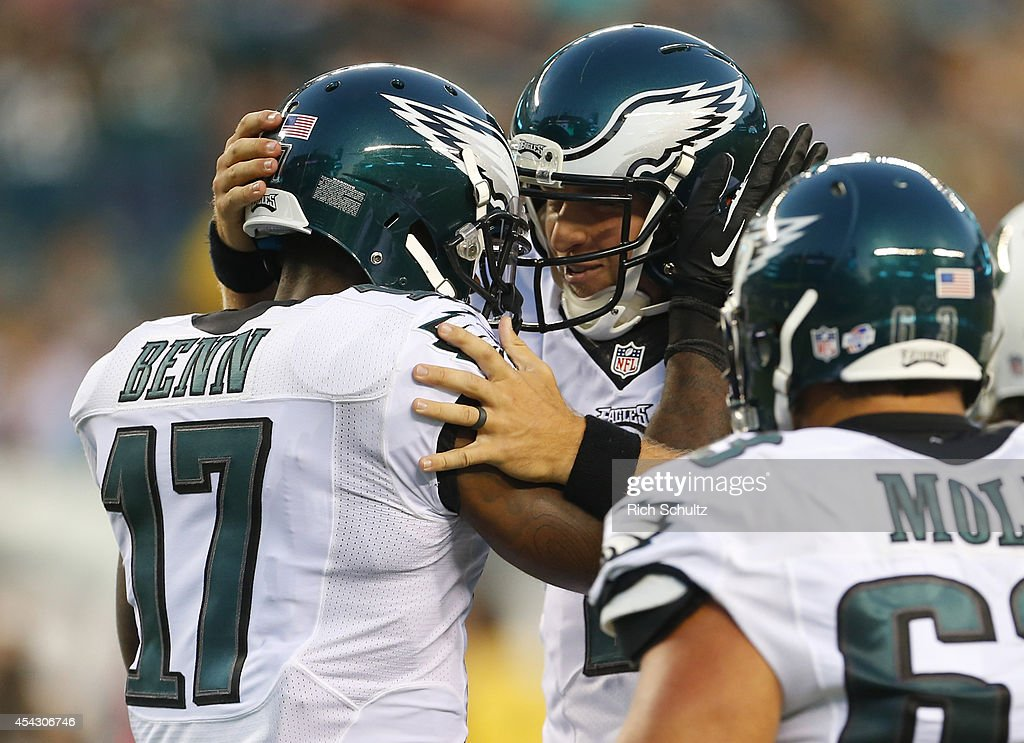 Quarterback Matt Barkley #2 of the Philadelphia Eagles reacts with wide receiver Arrelious Benn #17 after Benn caught a touchdown pass in the preseason game against the New York Jets on August 28, 2014 at Lincoln Financial Field in Philadelphia, Pennsylvania.