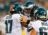 Quarterback Matt Barkley of the Philadelphia Eagles reacts with wide receiver Arrelious Benn after Benn caught a touchdown pass in the preseason game...