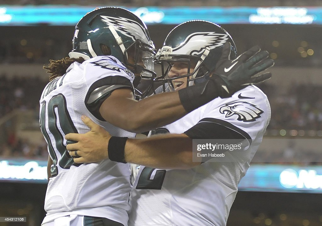 Quarterback Matt Barkley #2 of the Philadelphia Eagles reacts with wide receiver Quron Pratt #10 after scoring a touchdown in the preseason game against the New York Jets on August 28, 2014 at Lincoln Financial Field in Philadelphia, Pennsylvania.