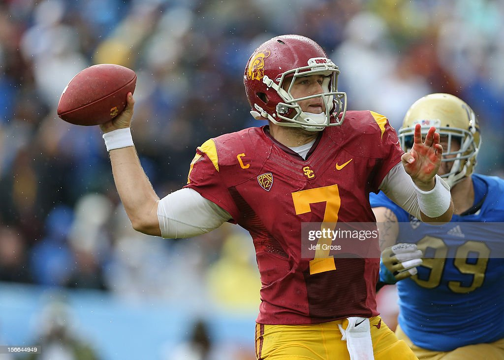 Quarterback <a gi-track='captionPersonalityLinkClicked' href=/galleries/search?phrase=Matt+Barkley&family=editorial&specificpeople=5528198 ng-click='$event.stopPropagation()'>Matt Barkley</a> #7 of the USC Trojans drops back to pass against the UCLA Bruins in the second half at the Rose Bowl on November 17, 2012 in Pasadena, California. UCLA defeated USC