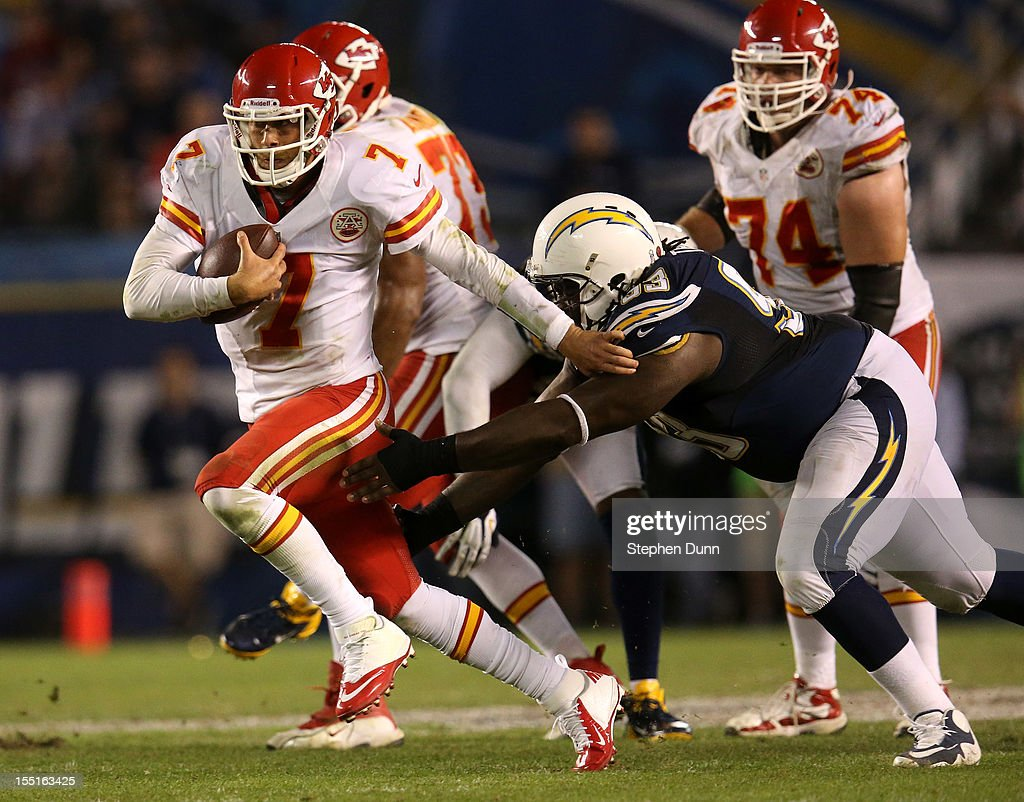 Quarterback <a gi-track='captionPersonalityLinkClicked' href=/galleries/search?phrase=Matt+Cassel&family=editorial&specificpeople=567575 ng-click='$event.stopPropagation()'>Matt Cassel</a> #7 of the Kansas City Chiefs scrambles against defensive tackle Cam Thomas #93 of the San Diego Chargers at Qualcomm Stadium on November 1, 2012 in San Diego, California. The Chargers won 31-13.