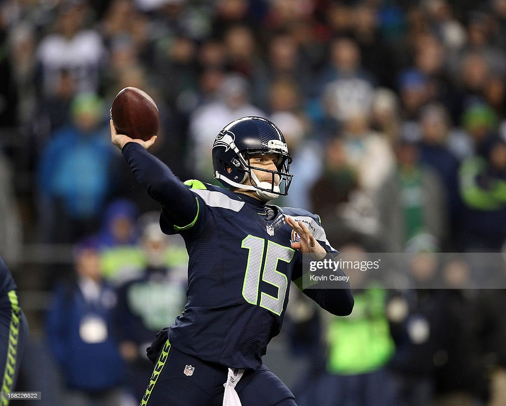 Quarterback Matt Flynn #15 of Seattle Seahawks throws in the third quarter against the Arizona Cardinals at CenturyLink Field on December 9, 2012 in Seattle, Washington.