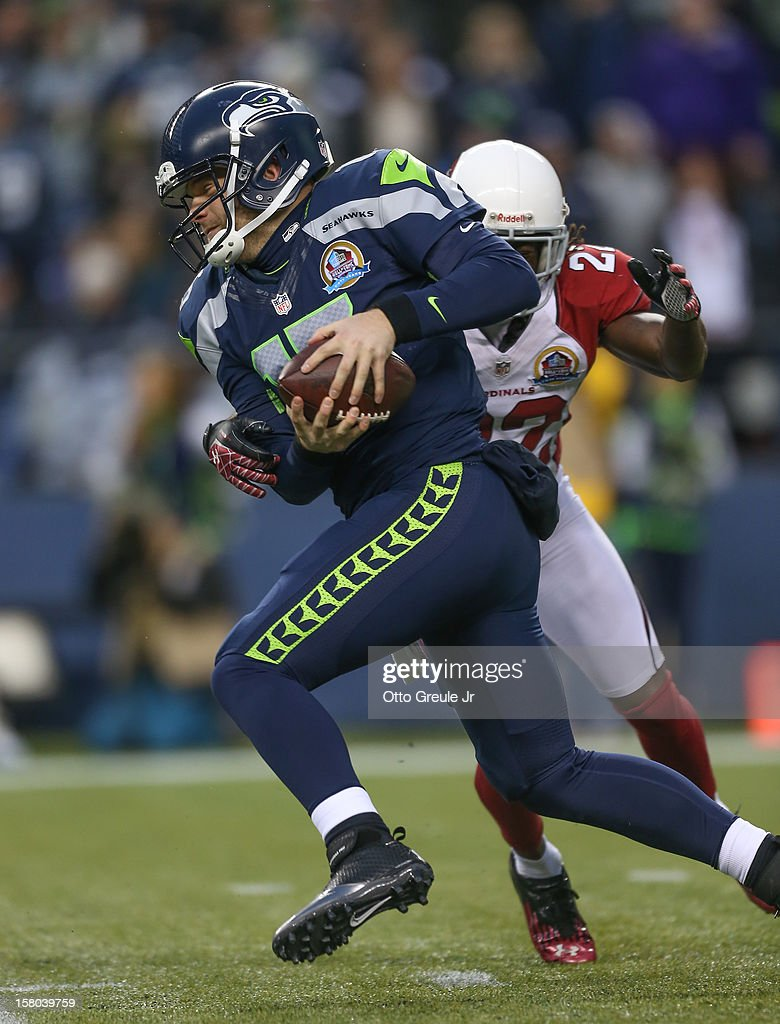 Quarterback Matt Flynn #15 of the Seattle Seahawks rushes against cornerback William Gay #22 of the Arizona Cardinals at CenturyLink Field on December 9, 2012 in Seattle, Washington. The Seahawks defeated the Cardinals 58-0.