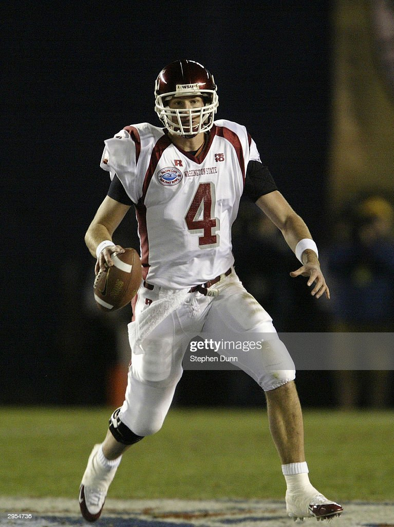 Quarterback Matt Kegel #4 of the Washington State Cougars looks to pass during the game against the University of Texas Longhorns in the Pacific Life Holiday Bowl on December 30, 2003 at Qualcomm Stadium in San Diego, California. Washington State defeated Texas 28-20.